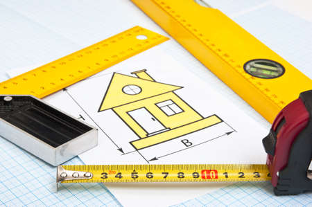 construction drawings and tools on graph paper photo