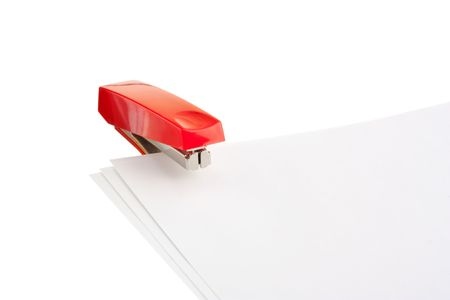 red stapler isolated on white background photo