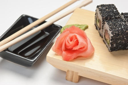 Traditional Asian food sushi on wooden plate  photo