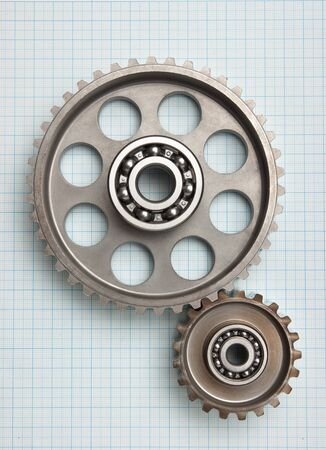 gears and bearings on graph paper photo