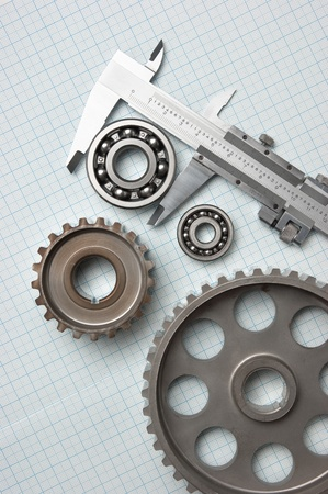 bearings: caliper with gears and bearings on graph paper