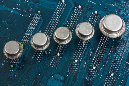 old silicon chip on the electronic board photo