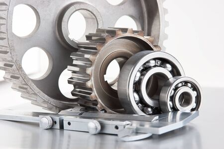 bearings: gears and bearings with calipers on a metal plate
