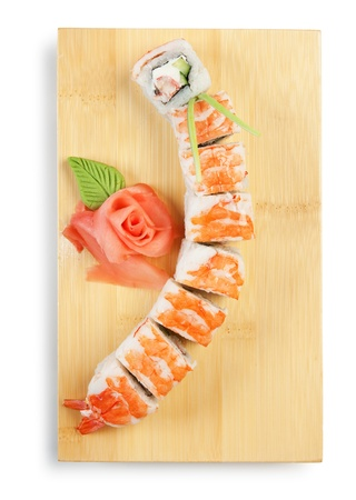 Asian food sushi on wooden plate isolated on white background photo