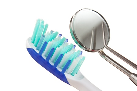 toothbrush and dental Instruments isolated on a white  background  photo