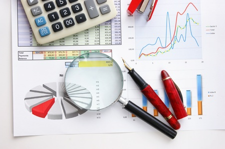 pen, magnifying glass and the working paper with a diagram Stock Photo - 8848589