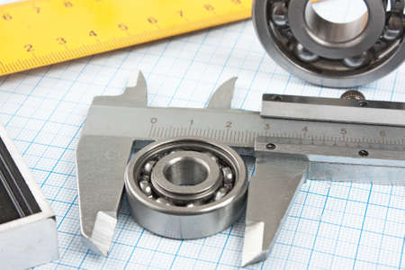 setsquare and calliper with bearing on graph paper photo