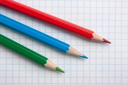 red  green blue pencils and notebook photo