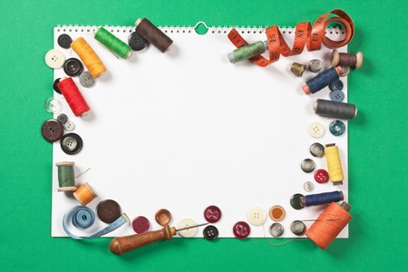 craft button: still life of spools of thread -frame