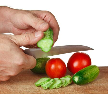 chop tomatoes and cucumbers  isolated  on white background photo