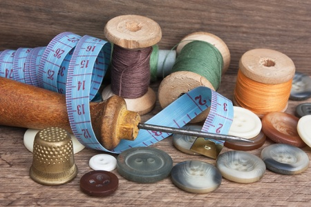 craft button: still life of spools of thread on a wooden background