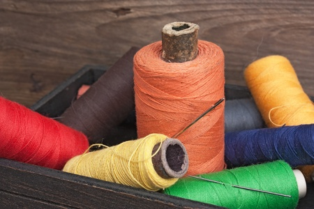 still life of spools of thread on a wooden background Stock Photo - 8849250