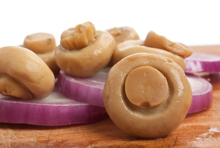mushrooms and onions on a cutting board photo