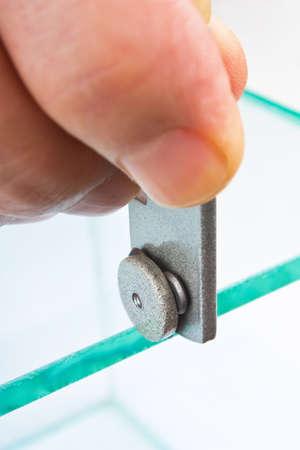 glasscutter: glazier cut transparent glass, close-up Stock Photo