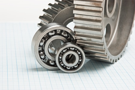 gears and bearings on graph paper Stock Photo