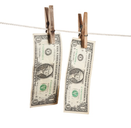 dollar is hanging on a wooden clothespin isolated on white background photo