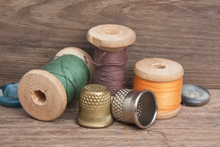 tailor's: still life of spools of thread on a wooden background