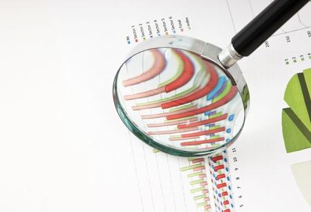 pen, magnifying glass and the working paper with a diagram Stock Photo - 8855279