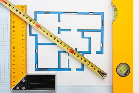 development drawings and tools on graph paper photo