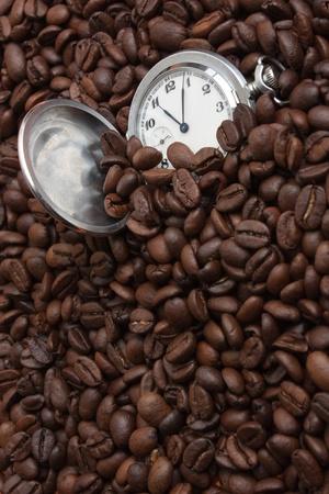 winnower: pocket watch in a pile of coffee beans