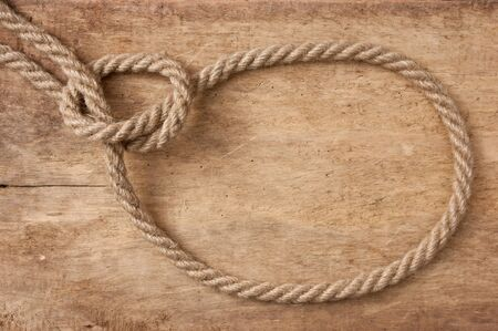 bonding rope: lasso rope on a wooden background