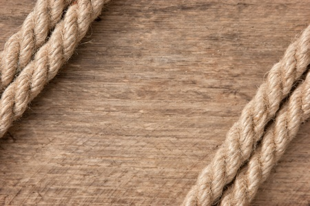 bonding rope: frame made of rope on a wooden background