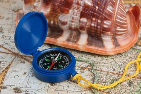 seashell and compass, still life photo