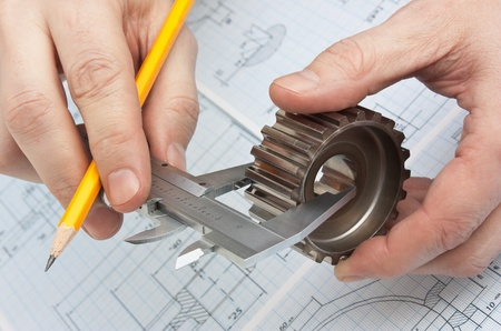 technical drawing and tools in hand photo