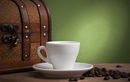 winnower: glass jar with a cup of coffee Stock Photo