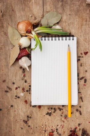 notebook for recipes and spices on an old wooden table Stock Photo