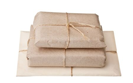pile parcel wrapped with brown kraft paper isolated on white background photo