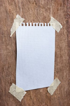 pinning: reminder notes on a background of the old wooden logs