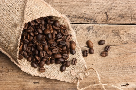 winnower: coffee beans in a bag on a wooden background Stock Photo