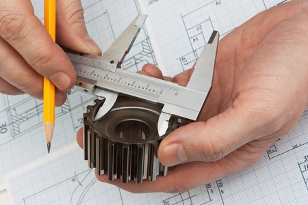mechanical engineering: technical drawing and tools in hand