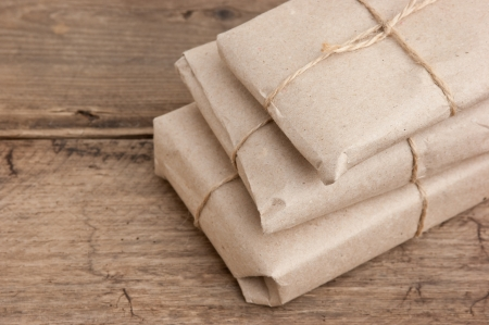 package: pile parcel wrapped with brown kraft paper and tied with twine