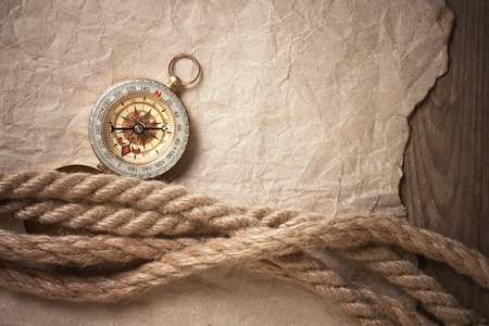 compass, old paper and rope, still-life photo