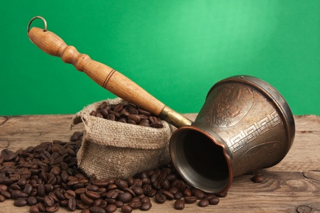 winnower: bag of coffee beans and an coffee maker Stock Photo