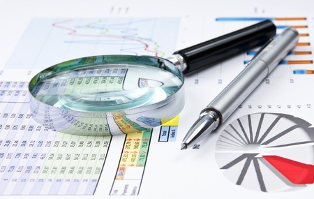 pen, magnifying glass and the working paper with a diagram Stock Photo - 9469714