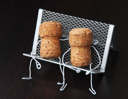 two wine corks are sitting on a bench photo
