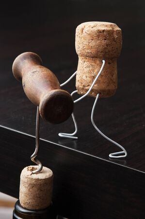 joking:  wine corks and bottle with the corkscrew Stock Photo