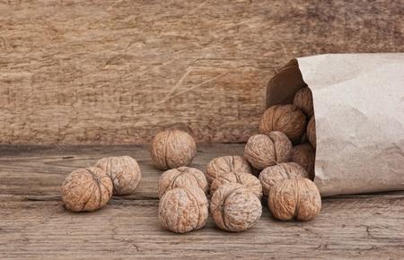walnuts in a brown kraft paper bag photo