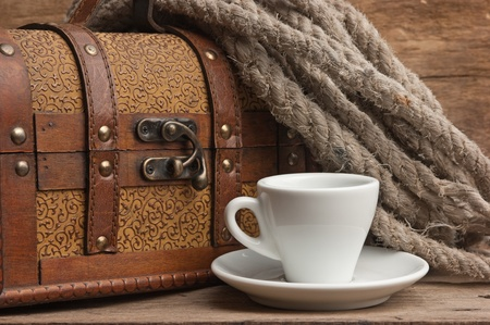 winnower: cup of coffee and a chest, still life