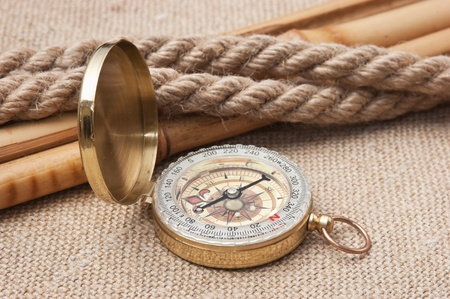 Compass with ropes and bamboo on a canvas photo