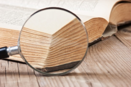 old open book and magnifying glass Stock Photo - 9829730