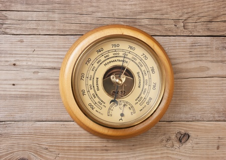 aneroid: aneroid barometer on a wooden wall