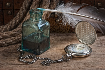 old pocket watch and inkwell, still life photo