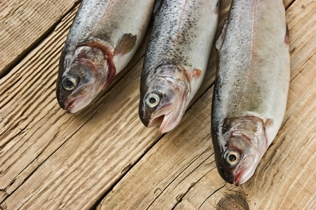 clr: rainbow trout on a wooden board
