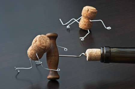 joking: two wine corks and bottle with corkscrew Stock Photo