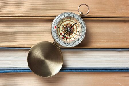 compass and the old books photo