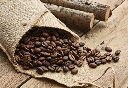 coffee beans in a bag on a wooden background photo